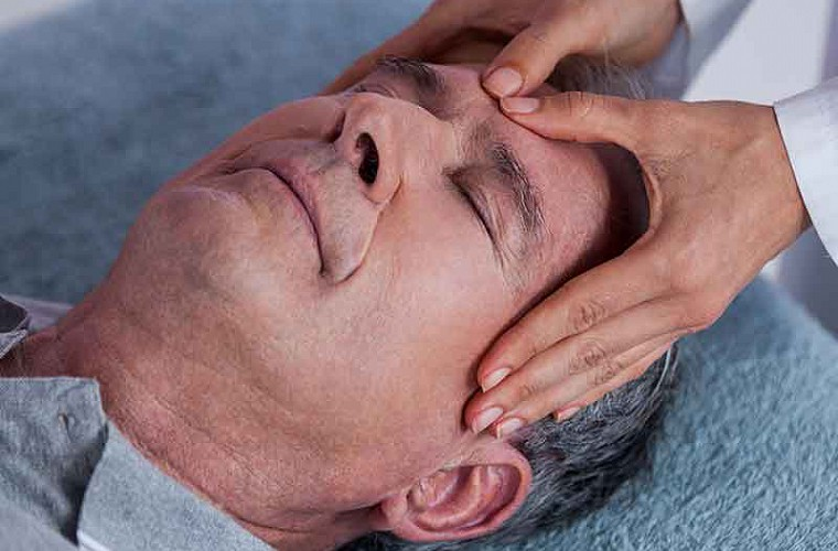 Cranial osteopathic treatment in action image of