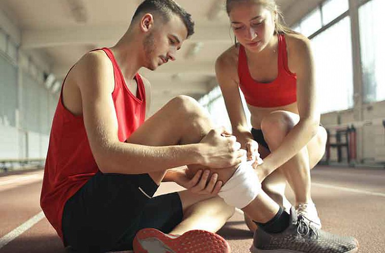 sports injury rehab treatment in action image of